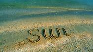 Inscription the sun on sand, the beach. Stock Footage