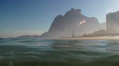Gavea stone, pedra da Gavea, Rio de Janeiro seen from beach Stock Footage