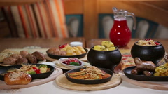 Rich laid food table Stock Footage