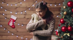 Woman holding horse xmas toy hands Stock Footage