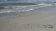 Inscription business on sand. Stock Footage