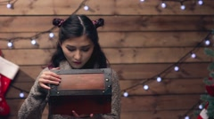 Happy Little Girl Opening a Present magic Box Stock Footage