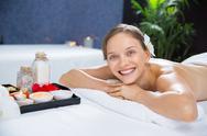 Smiling woman enjoying aromatherapy in spa salon Stock Photos