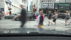 Teenage girls stop in middle of busy city crosswalk Stock Footage