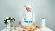 Young baker playing with dough and laughing at camera isolated on white Stock Footage
