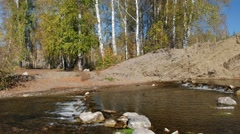 Panorama of waterfall and rocks on river Vydriha near village Belovo in Novos Stock Footage