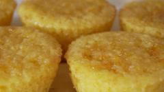 Freshly cooked lemon cupcakes closeup Stock Footage