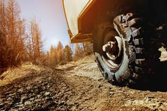 Wheel of car SUV on the offroad background Stock Photos