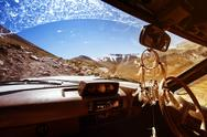 Car SUV on the mountains background window view Stock Photos