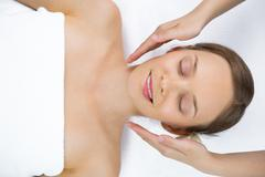 Young woman in expectation of facial massage Stock Photos