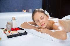 Young woman lying and enjoying aromatherapy in spa Stock Photos