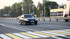 A man crossing the road at the crosswalk Stock Footage