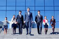Business people at stairs Stock Photos