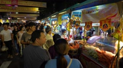 People shopping and eating for celebrate a Chinese Vegetarian Festival Stock Footage