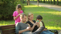 Family indulge. doing selfie in the park. virtual faces for selfie. Live Filters Stock Footage