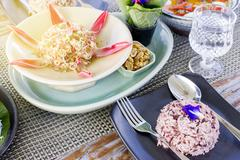 Thai food set menu on outdoor table with orange sun glare Stock Photos