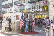 People taking pictures and selfies at check point Charlie, Berlin, Germany. Stock Photos