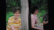 1972: people outdoors on wooden bench in the woods LYNBROOK, NEW YORK Stock Footage