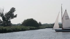Yachts zig-zagging on the River Bure Stock Footage