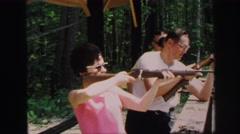 1972: woman and men holding guns at shooting range LYNBROOK, NEW YORK Stock Footage