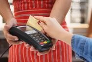 Customer paying by card in cafe Stock Photos