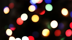 Blurred twinkling lights on dark background Stock Footage