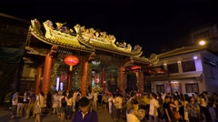 Many people come to worship and ask for blessings in Kuan Yim Shrine Stock Footage