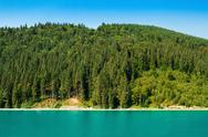 Beautiful view of boat in lake, forest and mountains Stock Photos