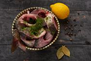 Fresh fish pieces in a bowl with spices and lemon Stock Photos