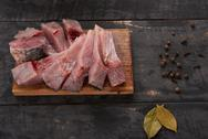 Pieces of fresh fish carp on a table Stock Photos