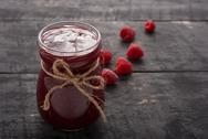 Raspberry jam and berries on the table Stock Photos