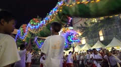 Dragon dance show team using fireworks and drum to entertain people Stock Footage