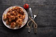 Chicken a barbecue and tomato in cafes top view Stock Photos