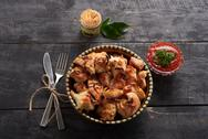 Chicken barbecue on wooden table Stock Photos