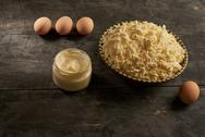 Cottage cheese, sour cream and eggs on the wooden table Stock Photos