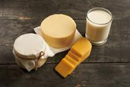 Delicious dairy products on a wooden table Stock Photos