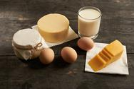 Eggs, butter, milk, sour cream on the table Stock Photos