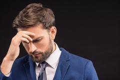 Thoughtful businessman solving big problem Stock Photos