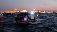 White Motor-boat Outruns Other Vessels on the River at Night Arkistovideo