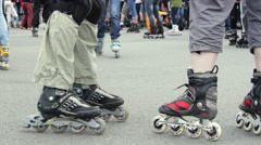 Crowd of People on Roller Skates. Rollerblades Close Up Stock Footage