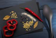 Abstract cooking pepper, spices on blue background Stock Photos