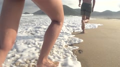 Couple runing in beach in slowmotion Stock Footage