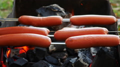 Fried Sausages on the Grill Stock Footage