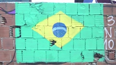 Brazilian flag painted at favela wall Stock Footage