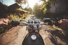 Young man riding on a motorcycle Stock Photos