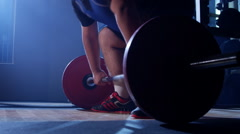 Proffesional weightlifter training exercising and lifting weights. Stock Footage