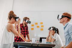 Business team using virtual reality headset in meeting Stock Photos