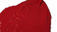 Red liquid flow falls from above and fills screen. Colored paint Stock Footage
