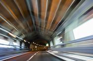 Motion Blur Driving Car at Speed Through a Tunnel Stock Photos