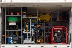 Light Tower, coil extension, spinal board and other equipment in a fire truck Stock Photos